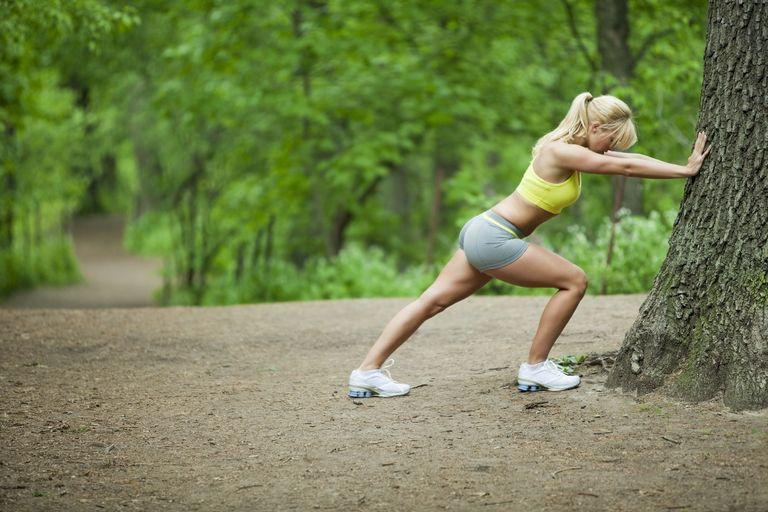 Runner stretching her calves