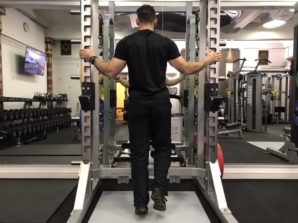 Standing single leg calf raise home exercise