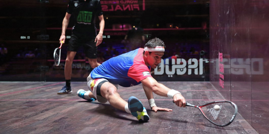 Squash player lunging to the side